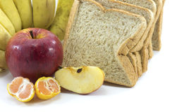 Mixed Fruits and Bread on white background Royalty Free Stock Photos
