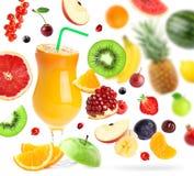 Mixed fruits falling and orange juice Royalty Free Stock Photos