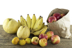 Mixed fruits of natural light. On wood background Stock Photos