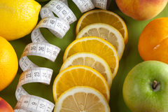 Mixed fruits and tape measure Stock Image