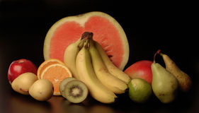 Mixed fruits and vegetables with a black background,fruits Royalty Free Stock Images