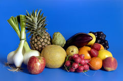 Mixed fruits and vegetables with a blue background,fruits Stock Images