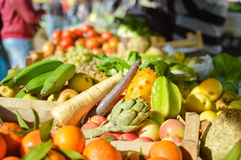 Mixed fruits and vegetables on market stall Stock Photos
