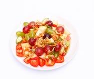 Mixed fruits and vegetables salad. Mixed fruits and vegetables salad on plate Stock Photo