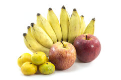Mixed Fruits on white background. Mixed Fruits include Red ripe apple  banana oranges and other Stock Photos