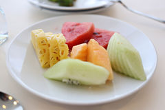 Mixed fruits in white dish. Royalty Free Stock Images