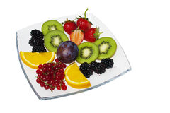 Mixed fruits on white plate Stock Images