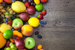 Mixed Fruits on the wooden table with water drops Royalty Free Stock Photography