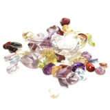Mixed Gemstones. A handfull of mixed genuine gemstones isolated on white Stock Photography