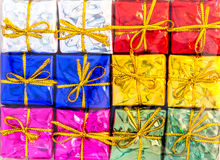 Mixed glitter color of mini gift box under transparent plastic wrapped as background Royalty Free Stock Photo