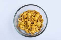 Mixed granola. In glass bowl on white background Royalty Free Stock Photos