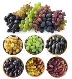 Mixed grapes of different varieties. Grapes in a wooden bowl isolated on white background. Blue, yellow, red and green grapes on w stock photos