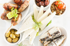 Mixed Greek Mezze. For Ouzo, includes Meat balls, Graviera, olives, aubergine salad, sardines & tzaziki Served with Pita Bread royalty free stock images