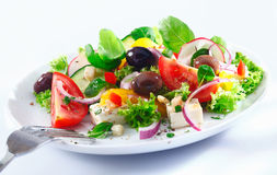 Mixed Greek salad on a plate Royalty Free Stock Images