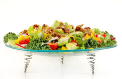 Mixed green salad with beef meat. Presented on a glass plate , with white isolated background stock photos