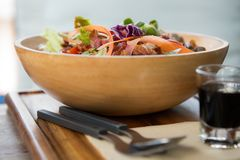 Mixed green salad in a bowl royalty free stock image