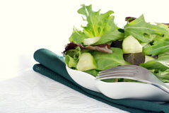 Mixed green salad with cucumber Royalty Free Stock Image