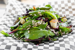Mixed green salad with jalapeño dressing and toasted pumpkin seeds Royalty Free Stock Image