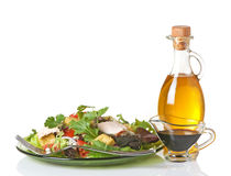Mixed Greens Salad With Oil And Vinegar. Mixed greens salad with olive oil and balsamic vinegar on the side stock photo