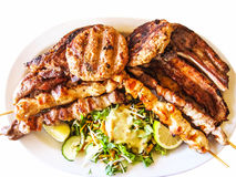 Mixed grill. Style Europe ,beef, chicken, pork, lamb and salad Stock Photography