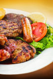 Mixed grill on a plate Stock Image