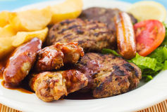 Mixed grill on a plate Royalty Free Stock Images