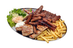 Mixed grill with salad and french fries. Mixed meat grill with salad and french fries Stock Photo