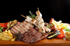 Mixed grilled meat. Platter on black background royalty free stock photos