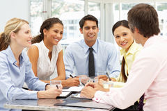 Mixed group in business meeting. Discussing Royalty Free Stock Photos