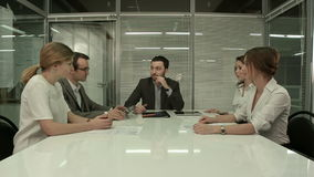 Mixed group in business meeting stock footage