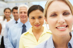 Mixed group business people in line Royalty Free Stock Photos