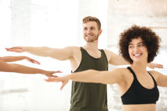 Mixed group of fitness people doing exercises royalty free stock image