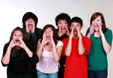 Mixed group of kids yelling. Diverse group of multi-ethnic kids shouting Stock Photo