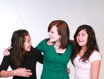 Mixed group of laughing teen girls. Diverse group of three pretty girls laughing Royalty Free Stock Photos