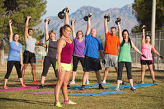 Mixed Group Lifting Kettle Bells Stock Photos
