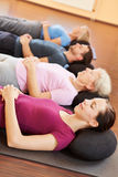 Mixed group relaxing in fitness Stock Photography
