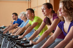 Mixed group in spinning class Royalty Free Stock Images