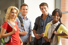 Mixed group of students in college stock photos