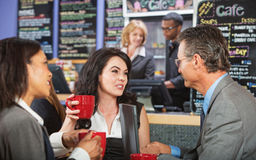 Mixed Group Talking in Cafe Royalty Free Stock Images