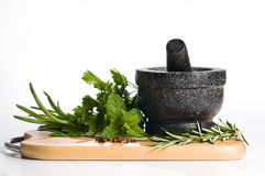 Mixed Herbs on Chopping Board Stock Images