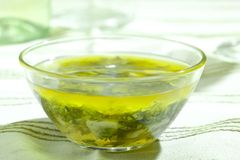 Mixed herbs in olive oil Royalty Free Stock Photography