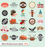 Mixed Holiday Labels and Stickers. Collection of vintage style mixed holiday labels and stickers including Christmas, Halloween, Birthday, and Thanksgiving Stock Photo