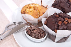 Mixed homemade muffins on a plate Royalty Free Stock Photos