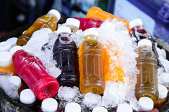 Mixed ice cold juice bottles Royalty Free Stock Image