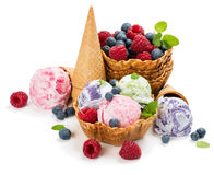 Mixed ice cream scoops. Different ice cream and berries in a wafer cones and bowl  on white background Stock Image