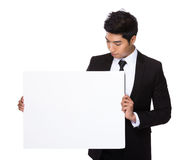 Mixed Indian businessman hold with white board Stock Image
