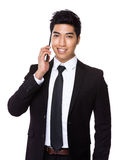 Mixed Indian businessman talk to mobile phone Stock Photo
