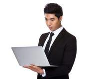 Mixed Indian businessman use of laptop Stock Photo