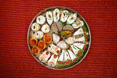 Mixed Indian sweets with copyspace Stock Images