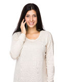 Mixed indian woman talk to mobile phone Royalty Free Stock Images